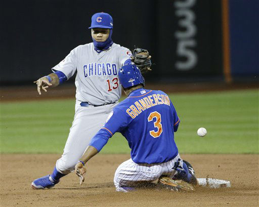 "<div class=""meta image-caption""><div class=""origin-logo origin-image none""><span>none</span></div><span class=""caption-text"">New York Mets' Curtis Granderson (3) steals second as Chicago Cubs' Starlin Castro has trouble with the throw. (AP Photo/ David J. Phillip)</span></div>"