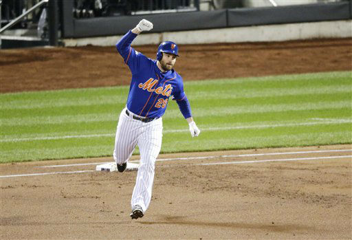 "<div class=""meta image-caption""><div class=""origin-logo origin-image none""><span>none</span></div><span class=""caption-text"">New York Mets' Daniel Murphy celebrates after hitting a two-run home run during the first inning of Game 2. (AP Photo/ David Goldman)</span></div>"