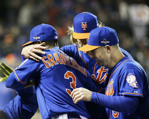 "<div class=""meta image-caption""><div class=""origin-logo origin-image none""><span>none</span></div><span class=""caption-text"">New York Mets' Curtis Granderson is congratulated after catching a ball at the wall hit by Chicago Cubs' Chris Coghlan. (AP Photo/ David J. Phillip)</span></div>"