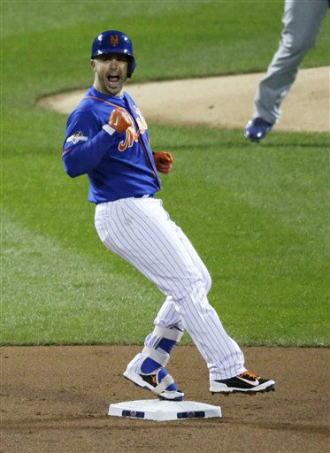 "<div class=""meta image-caption""><div class=""origin-logo origin-image none""><span>none</span></div><span class=""caption-text"">New York Mets' David Wright celebrates after hitting an RBI double during the first inning of Game 2. (AP Photo/ David Goldman)</span></div>"