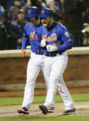 "<div class=""meta image-caption""><div class=""origin-logo origin-image none""><span>none</span></div><span class=""caption-text"">New York Mets' Daniel Murphy celebrates after hitting a two-run home run during the first inning of Game 2. (AP Photo/ David J. Phillip)</span></div>"