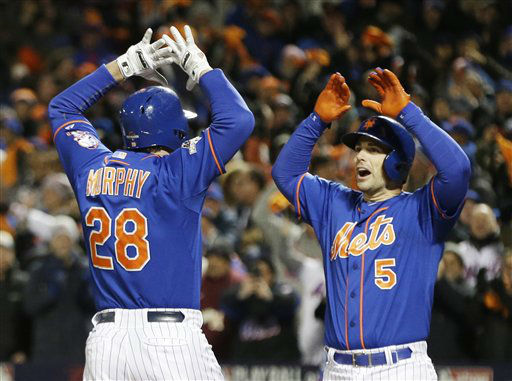 "<div class=""meta image-caption""><div class=""origin-logo origin-image none""><span>none</span></div><span class=""caption-text"">New York Mets' Daniel Murphy is congratulated by teammate David Wright. (AP Photo/ David J. Phillip)</span></div>"