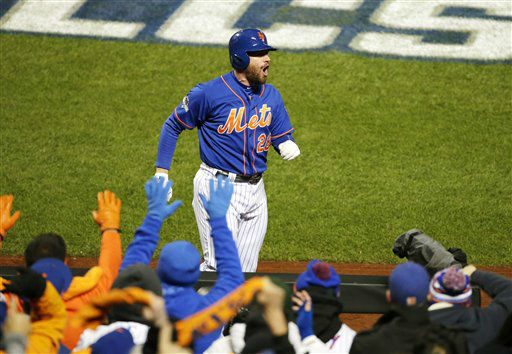 "<div class=""meta image-caption""><div class=""origin-logo origin-image none""><span>none</span></div><span class=""caption-text"">New York Mets' Daniel Murphy celebrates after hitting a two-run home run during the first inning of Game 2. (AP Photo/ Frank Franklin II)</span></div>"