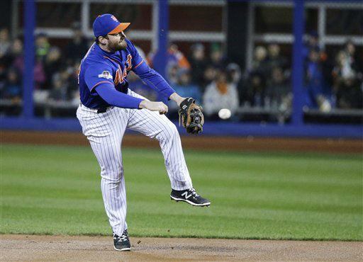 "<div class=""meta image-caption""><div class=""origin-logo origin-image none""><span>none</span></div><span class=""caption-text"">New York Mets' Daniel Murphy makes a play on a ball hit by Chicago Cubs' Dexter Fowler. (AP Photo/ Julie Jacobson)</span></div>"