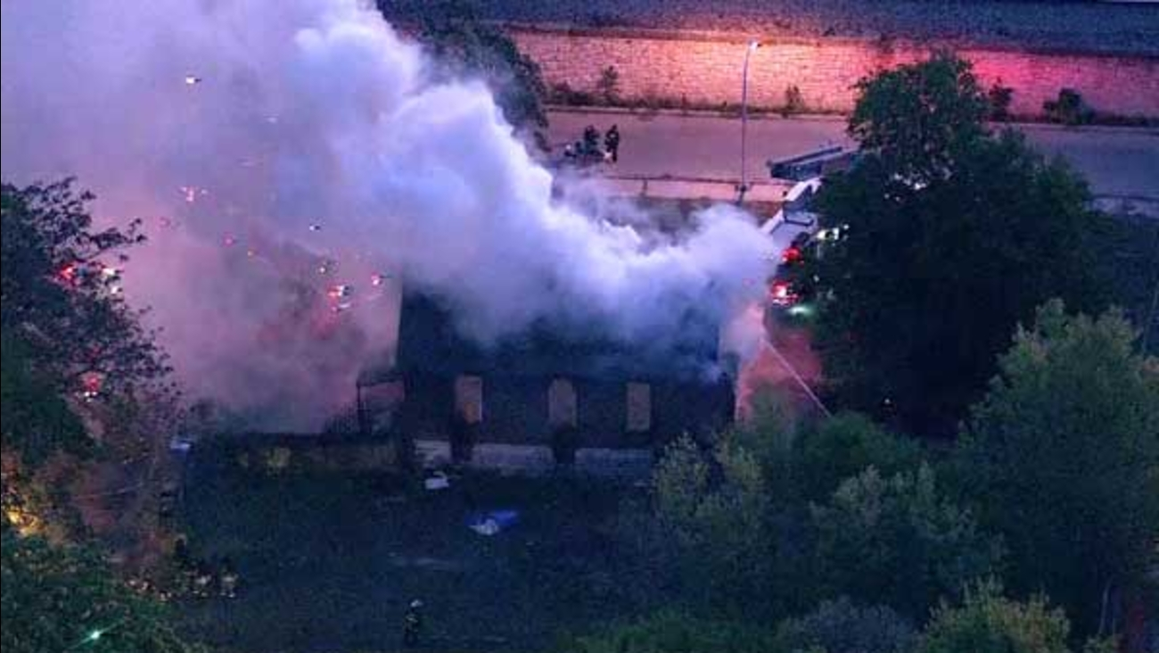 An abandoned home caught fire on Chicago's South Side. Smoke billowing out of the roof could be seen for miles.