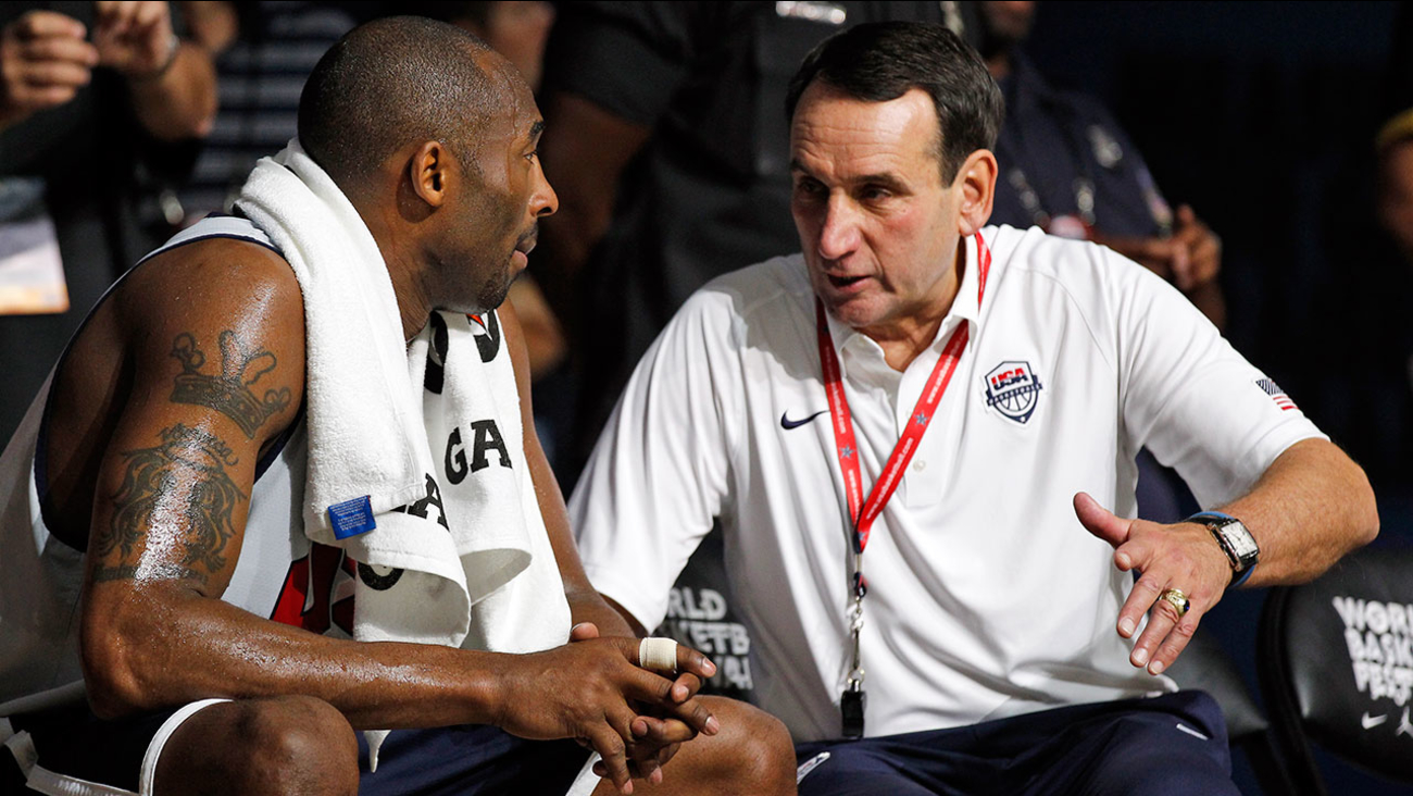 U.S. men's Olympic basketball team forward Kobe Bryant, left, talks with head coach Mike Krzyzewski during a practice Saturday, July 14, 2012, in Washington.