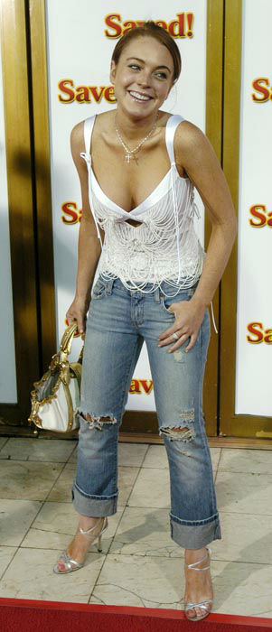 "<div class=""meta image-caption""><div class=""origin-logo origin-image none""><span>none</span></div><span class=""caption-text"">Actress Lindsay Lohan arrives to attend the premiere of the film ""Saved!"" in the Westwood section of Los Angeles, Thursday, May 13, 2004. (AP Photo/ CHRIS PIZZELLO)</span></div>"