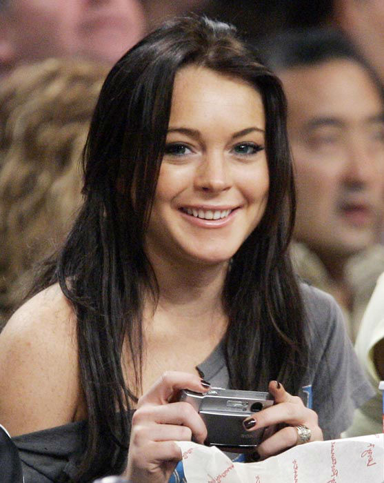 "<div class=""meta image-caption""><div class=""origin-logo origin-image none""><span>none</span></div><span class=""caption-text"">Actress Lindsay Lohan smiles at the camera as she watches the Los Angeles Lakers play the Atlanta Hawks in an NBA basketball game, last Friday night, Dec. 8, 2006. (AP Photo/ MARK J. TERRILL)</span></div>"