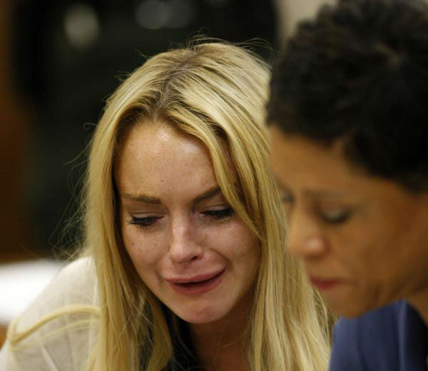 "<div class=""meta image-caption""><div class=""origin-logo origin-image none""><span>none</span></div><span class=""caption-text"">Actress Lindsay Lohan reacts after the sentencing by Superior Court Judge Marsha Reve during a hearing in Beverly Hills, Calif., Tuesday, July 6, 2010. (AP Photo/ David McNew)</span></div>"