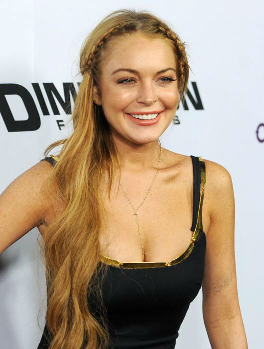 "<div class=""meta image-caption""><div class=""origin-logo origin-image none""><span>none</span></div><span class=""caption-text"">This April 11, 2013 file photo shows actress Lindsay Lohan, a cast member in ""Scary Movie V,"" at the premiere of the film in Los Angeles. (AP Photo/ Chris Pizzello)</span></div>"