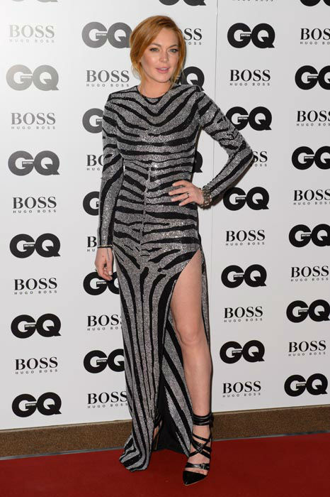 "<div class=""meta image-caption""><div class=""origin-logo origin-image none""><span>none</span></div><span class=""caption-text"">Lindsay Lohan arrives for the GQ Men Of The Year Awards 2014 at a central London venue, London, Tuesday, Sept. 2, 2014. (AP Photo/ Jonathan Short)</span></div>"