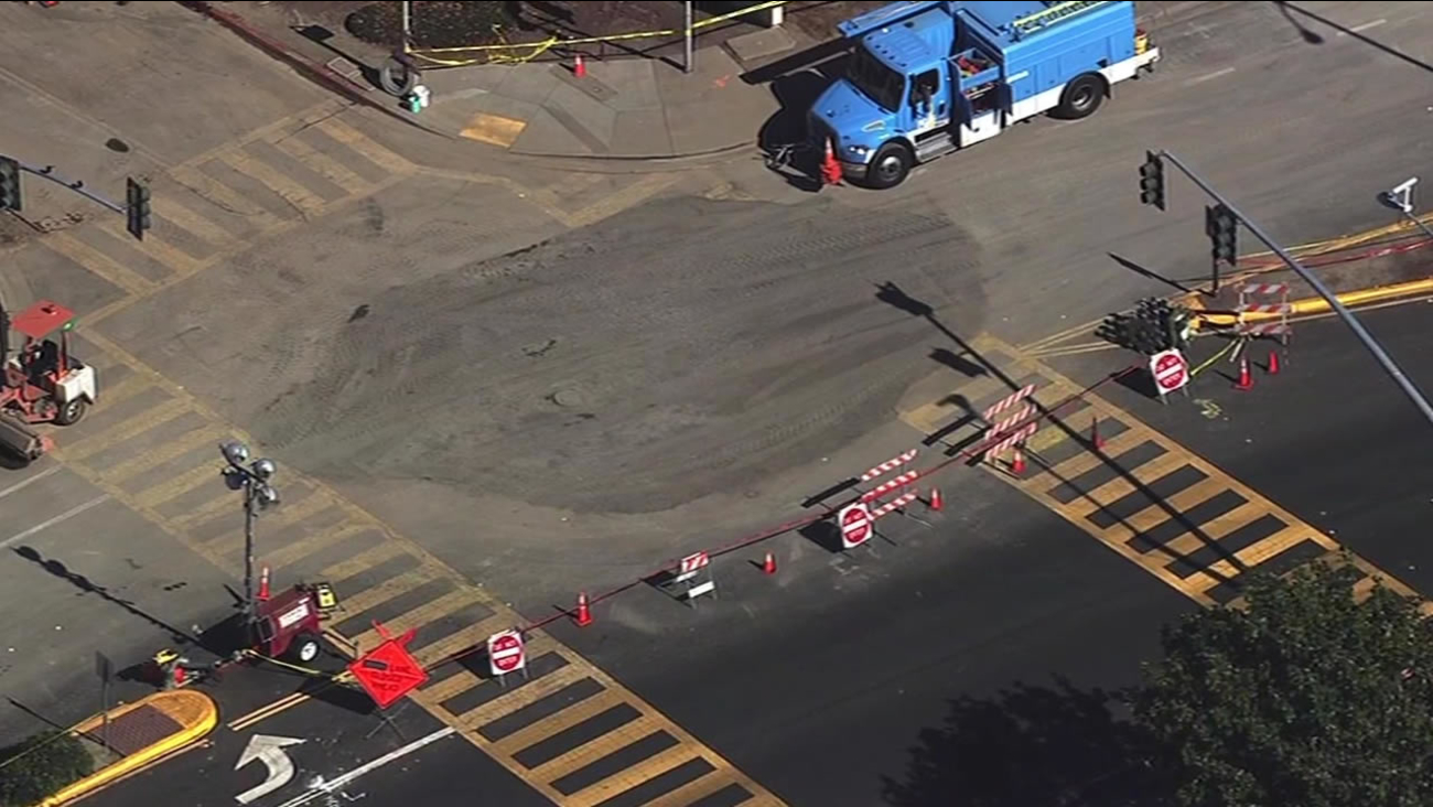 This image from Monday, October 19, 2015 shows crews finishing filling a sinkhole that opened up in Union City, Calif. on Wednesday, October 14, 2015.