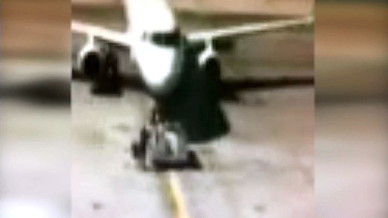 A man ran onto a tarmac to stop a plane from taking off at and airport in Denver on Tuesday, October 20, 2015.