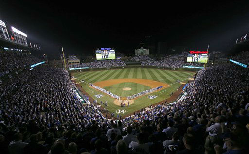 "<div class=""meta image-caption""><div class=""origin-logo origin-image none""><span>none</span></div><span class=""caption-text"">The Chicago Cubs and the New York Mets players line up during the national anthem before Game 3 of the National League baseball championship series. (AP Photo/Kiichiro Sato) (AP Photo/ Kiichiro Sato)</span></div>"