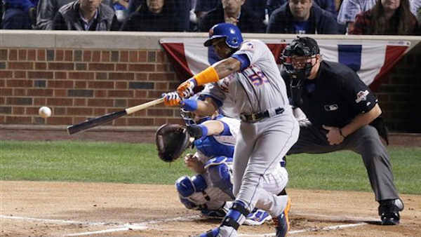 "<div class=""meta image-caption""><div class=""origin-logo origin-image none""><span>none</span></div><span class=""caption-text"">New York Mets' Yoenis Cespedes hits an RBI double during the first inning of Game 3 of the National League baseball championship series. (AP Photo/David Goldman)</span></div>"