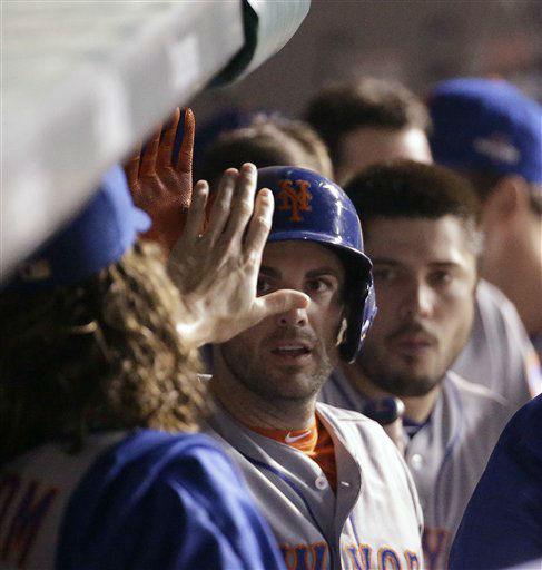 "<div class=""meta image-caption""><div class=""origin-logo origin-image none""><span>none</span></div><span class=""caption-text"">New York Mets' David Wright is congratulated after scoring during the first inning of Game 3 of the National League baseball championship series. (AP Photo/David J. Phillip) (AP Photo/ David J. Phillip)</span></div>"