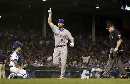 "<div class=""meta image-caption""><div class=""origin-logo origin-image none""><span>none</span></div><span class=""caption-text"">New York Mets' Daniel Murphy celebrates after hitting a home run during the third inning of Game 3. (AP Photo/David J. Phillip) (AP Photo/ David J. Phillip)</span></div>"