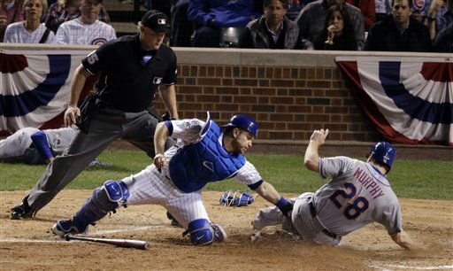 "<div class=""meta image-caption""><div class=""origin-logo origin-image none""><span>none</span></div><span class=""caption-text"">Mets' Daniel Murphy scores past Cubs catcher Miguel Montero during the seventh inning. Murphy scored from third on a ball hit by Lucas Duda. (AP Photo/David Goldman) (AP Photo/ David Goldman)</span></div>"