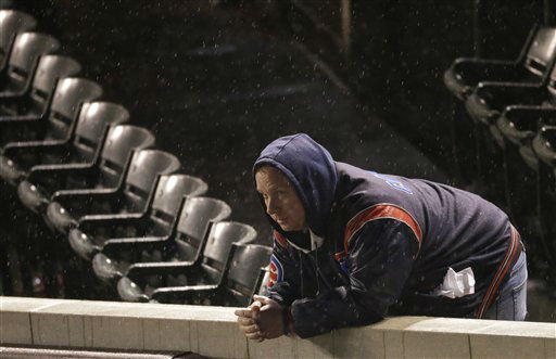 """<div class=""""meta image-caption""""><div class=""""origin-logo origin-image none""""><span>none</span></div><span class=""""caption-text"""">A Chicago Cubs fan reacts after Game 3 of the National League baseball championship series against the New York Mets. (AP Photo/David Goldman) (AP Photo/ David Goldman)</span></div>"""