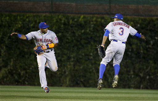 "<div class=""meta image-caption""><div class=""origin-logo origin-image none""><span>none</span></div><span class=""caption-text"">New York Mets' Curtis Granderson (3) and Yoenis Cespedes celebrate after Game 3. (AP Photo/David J. Phillip) (AP Photo/ David J. Phillip)</span></div>"