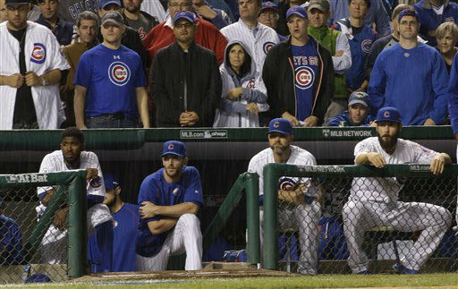 "<div class=""meta image-caption""><div class=""origin-logo origin-image none""><span>none</span></div><span class=""caption-text"">The Chicago Cubs bench watches during the ninth inning of Game 3. (AP Photo/David J. Phillip) (AP Photo/ David J. Phillip)</span></div>"