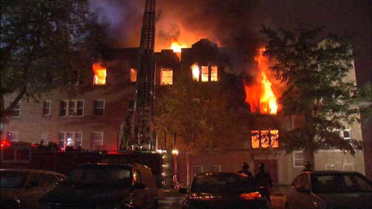 A massive fire destroyed an apartment building in west suburban Oak Park, displacing dozens of people overnight.