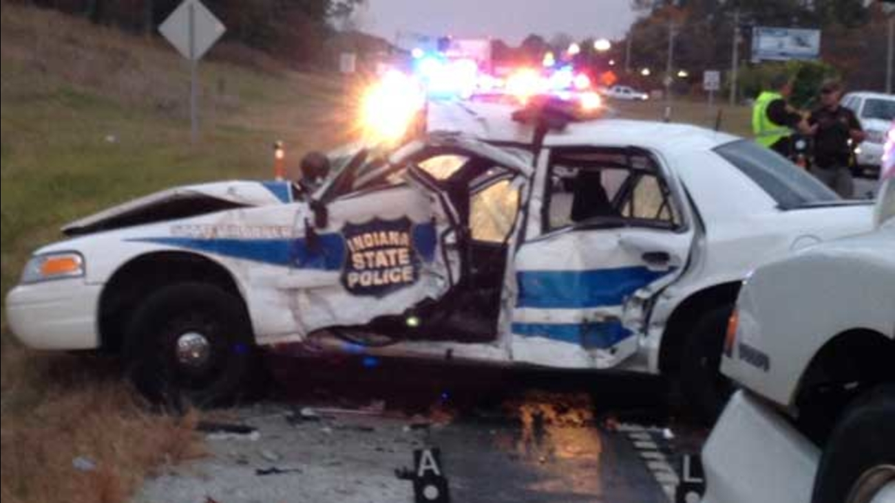 An Indiana state trooper was seriously injured after a semi crashed into his police car in Jasper County, Indiana.