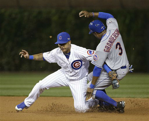 "<div class=""meta image-caption""><div class=""origin-logo origin-image none""><span>none</span></div><span class=""caption-text"">Mets' Curtis Granderson steals second with Chicago Cubs' Starlin Castro covering during the first inning of Game 4. (AP Photo/ David J. Phillip)</span></div>"