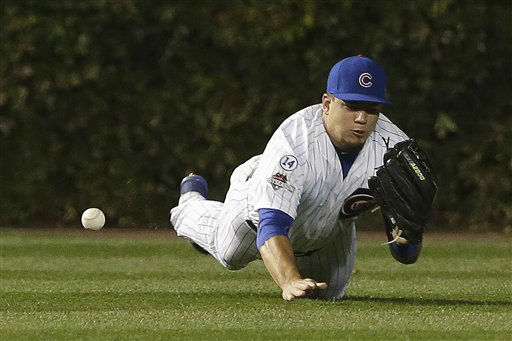 "<div class=""meta image-caption""><div class=""origin-logo origin-image none""><span>none</span></div><span class=""caption-text"">Chicago Cubs' Kyle Schwarber can't catch a ball hit by New York Mets' Wilmer Flores during the first inning of Game 4. (AP Photo/ David J. Phillip)</span></div>"