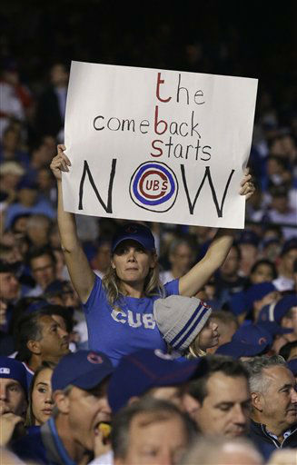 "<div class=""meta image-caption""><div class=""origin-logo origin-image none""><span>none</span></div><span class=""caption-text"">A Chicago Cubs fan holds up a sign from the stands during the second inning with the Mets leading 6-0. (AP Photo/ Nam Y. Huh)</span></div>"