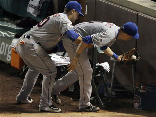 "<div class=""meta image-caption""><div class=""origin-logo origin-image none""><span>none</span></div><span class=""caption-text"">New York Mets' Michael Conforto, left, holds teammate Wilmer Flores as Flores catches a foul ball hit by Chicago Cubs' Javier Baez during the fourth inning. (AP Photo/ David Goldman)</span></div>"