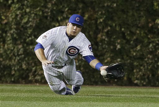 "<div class=""meta image-caption""><div class=""origin-logo origin-image none""><span>none</span></div><span class=""caption-text"">Chicago Cubs' Kyle Schwarber can't catch a ball hit by New York Mets' Wilmer Flores during the sixth inning. (AP Photo/ David J. Phillip)</span></div>"