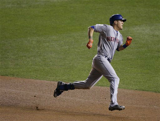 "<div class=""meta image-caption""><div class=""origin-logo origin-image none""><span>none</span></div><span class=""caption-text"">New York Mets' Wilmer Flores runs to third on a hit during the sixth inning. (AP Photo/ David Goldman)</span></div>"