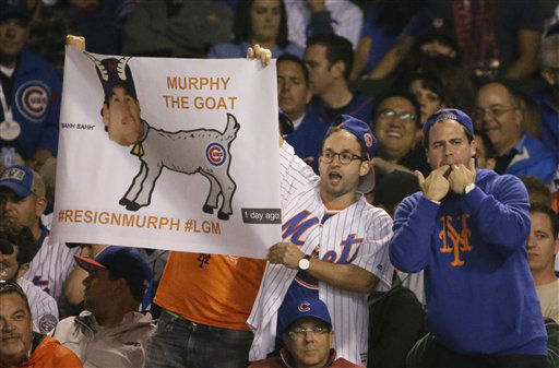 "<div class=""meta image-caption""><div class=""origin-logo origin-image none""><span>none</span></div><span class=""caption-text"">New York Mets fans cheer during the eighth inning. (AP Photo/ Nam Y. Huh)</span></div>"