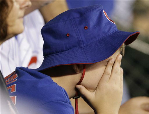 "<div class=""meta image-caption""><div class=""origin-logo origin-image none""><span>none</span></div><span class=""caption-text"">A Chicago Cubs reacts during the eighth inning of Game 4. (AP Photo/ David Goldman)</span></div>"