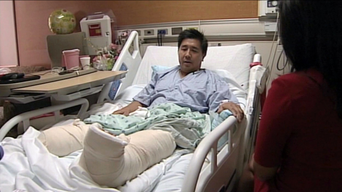 Tony Lee taks at a hospital after surviving a shark attack off the coast of Hawaii, Thursday, October 22, 2015.