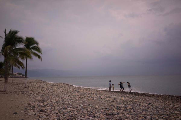 "<div class=""meta image-caption""><div class=""origin-logo origin-image none""><span>none</span></div><span class=""caption-text"">People throw stones into the ocean as hurricane Patricia nears in the Pacific resort city of Puerto Vallarta, Mexico, Thursday, Oct. 22, 2015. (AP Photo/ Cesar Rodriguez)</span></div>"