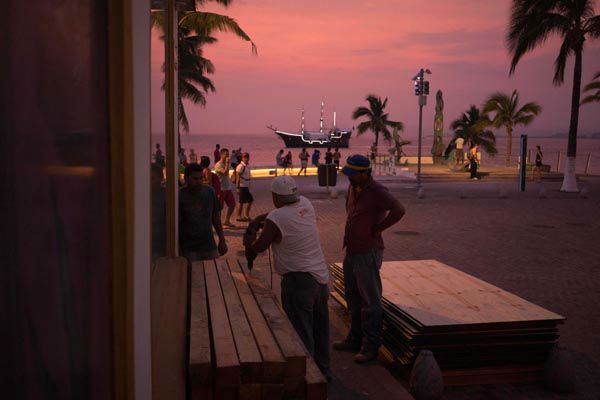 "<div class=""meta image-caption""><div class=""origin-logo origin-image none""><span>none</span></div><span class=""caption-text"">People preparing for the arrival of hurricane Patricia board up the windows of a seaside business in the Pacific resort city of Puerto Vallarta, Mexico, Thursday, Oct. 22, 2015. (AP Photo/ Cesar Rodriguez)</span></div>"