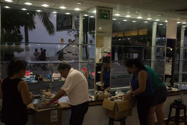 "<div class=""meta image-caption""><div class=""origin-logo origin-image none""><span>none</span></div><span class=""caption-text"">People preparing for the arrival of hurricane Patricia box their merchandise at a seafront jewelry shop in the Pacific resort city of Puerto Vallarta, Mexico. (AP Photo/ Cesar Rodriguez)</span></div>"