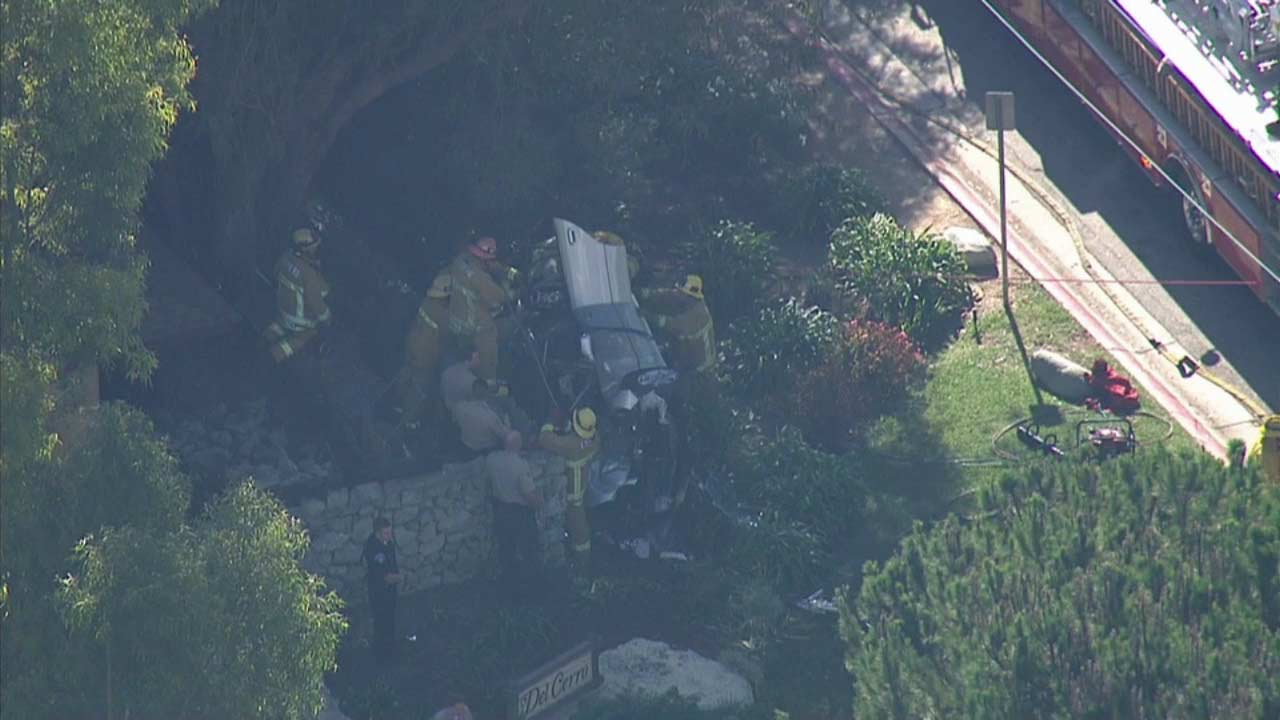 Burglary suspects led sheriff's deputies on a high-speed chase that ended with the car flipping on its side in Rancho Palos Verdes on Friday, Oct. 23, 2015.