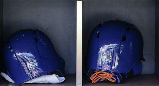 "<div class=""meta image-caption""><div class=""origin-logo origin-image none""><span>none</span></div><span class=""caption-text"">World Series logos decorate the backs of the batting helmets. (AP Photo/ Julie Jacobson)</span></div>"