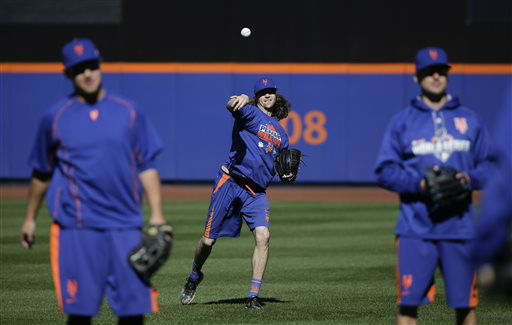 """<div class=""""meta image-caption""""><div class=""""origin-logo origin-image none""""><span>none</span></div><span class=""""caption-text"""">New York Mets starting pitcher Jacob deGrom throws in the outfield during a voluntary workout. (AP Photo/ Julie Jacobson)</span></div>"""
