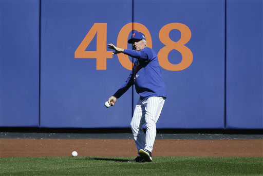 """<div class=""""meta image-caption""""><div class=""""origin-logo origin-image none""""><span>none</span></div><span class=""""caption-text"""">New York Mets manager Terry Collins throws balls back from the outfield. (AP Photo/ Julie Jacobson)</span></div>"""
