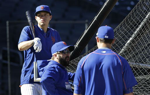 """<div class=""""meta image-caption""""><div class=""""origin-logo origin-image none""""><span>none</span></div><span class=""""caption-text"""">New York Mets' Wilmer Flores, left, waits his turn at the batting cage. (AP Photo/ Julie Jacobson)</span></div>"""