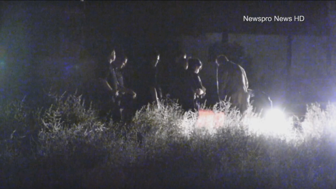 Authorities investigate after a body was discovered in a field near the 1400 block of East Lynwood Drive in San Bernardino on Friday, Oct. 23, 2015.