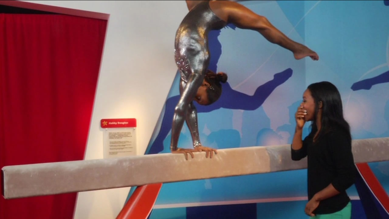 Olympic gymnast Gabby Douglas reacts to the unveiling of her wax figure at Madame Tussaud's at Fisherman's Wharf in San Francisco.
