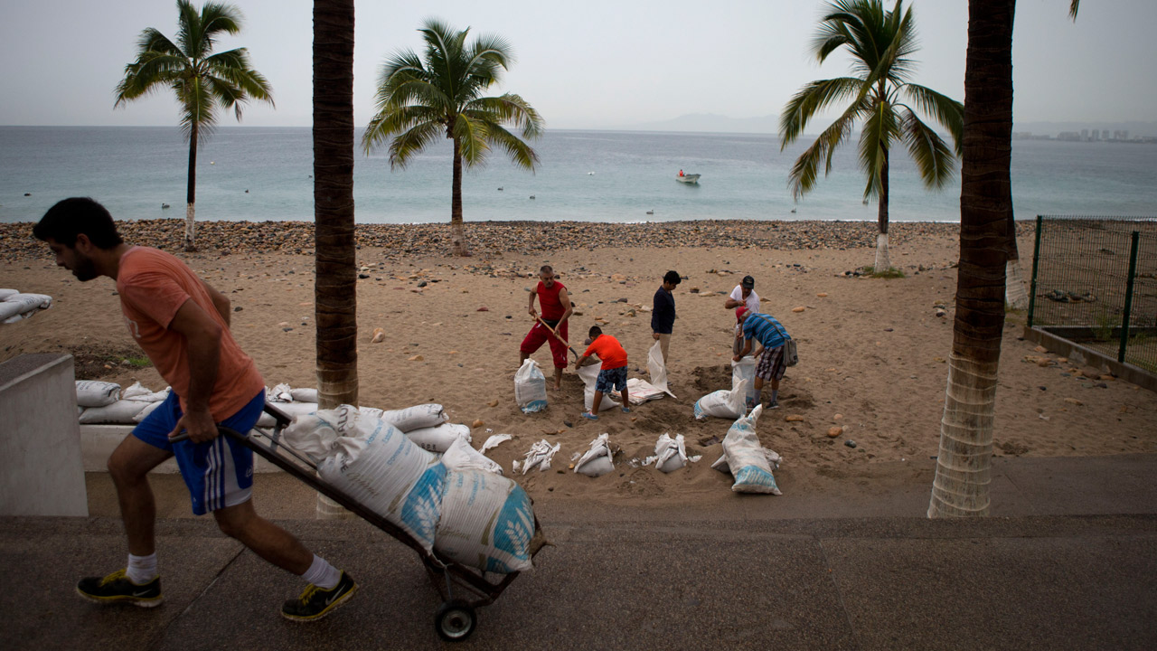 Residents prepare for the arrival of Hurricane Patricia filling sand bags to protect beachfront businesses, in Puerto Vallarta, Mexico, Friday, Oct. 23, 2015.