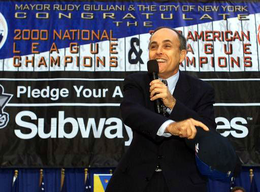 """<div class=""""meta image-caption""""><div class=""""origin-logo origin-image none""""><span>none</span></div><span class=""""caption-text"""">Mayor Rudy Giuliani gets the crowd going during a city sponsored rally for tMets fans and Yankees fans in New York's Bryant Park. (AP Photo/Beth A. Keiser)</span></div>"""