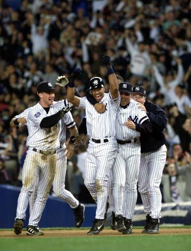 """<div class=""""meta image-caption""""><div class=""""origin-logo origin-image none""""><span>none</span></div><span class=""""caption-text"""">Members of the New York Yankees crowd around Jose Vizcaino, center, and celebrate after his game winning single in Game 1. (AP Photo/Amy Sancetta)</span></div>"""