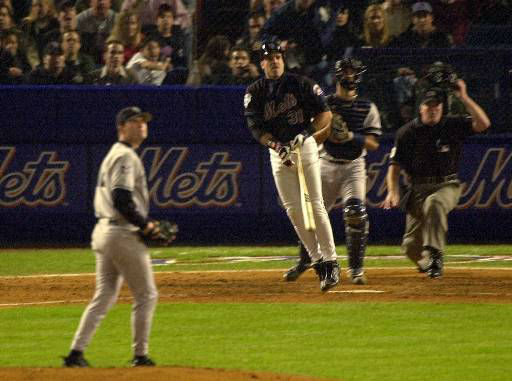 """<div class=""""meta image-caption""""><div class=""""origin-logo origin-image none""""><span>none</span></div><span class=""""caption-text"""">Mike Piazza, center, watches his two-run home run off Yankees pitcher Denny Neagle, left, sail into the bleachers in Game 4. (AP Photo/Bill Kostroun)</span></div>"""